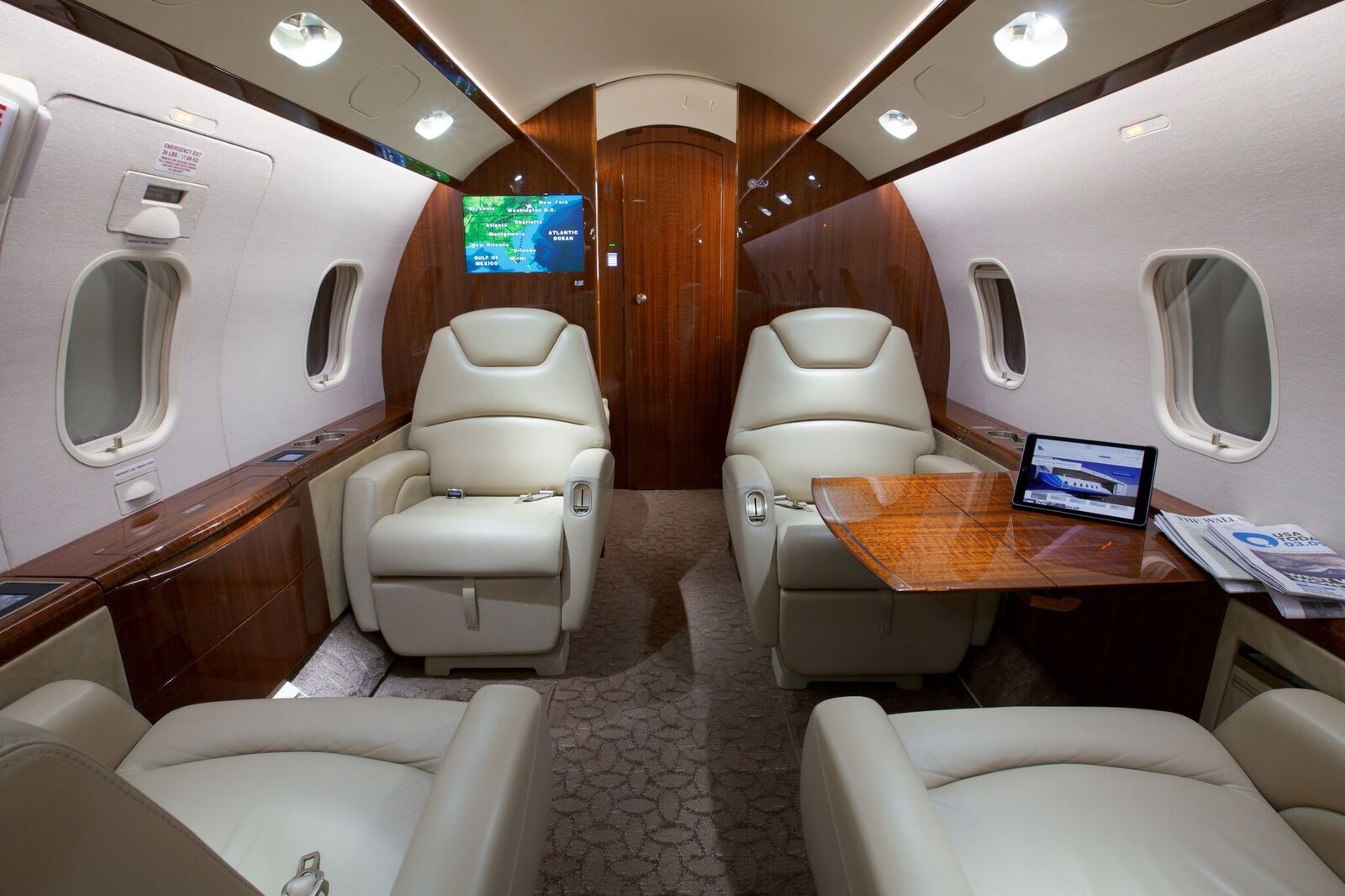 Challenger 300 cabin area with reclining seats and table